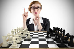 Composite image of thinking redhead businesswoman Royalty Free Stock Photography