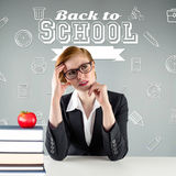 Composite image of thinking redhead teacher Royalty Free Stock Image