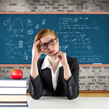 Composite image of thinking redhead teacher Stock Photo