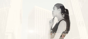 Composite image of thoughtful asian businesswoman Stock Photo