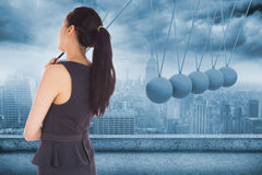 Composite image of thoughtful asian businesswoman Stock Image