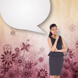 Composite image of thoughtful asian businesswoman with speech bubble Royalty Free Stock Image