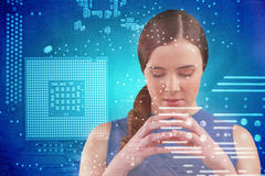Composite image of thoughtful beautiful woman. Thoughtful beautiful woman against micro parts in computer chip Stock Photo