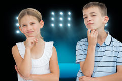 Composite image of thoughtful brother and sister posing together Royalty Free Stock Photo