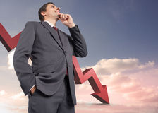 Composite image of thoughtful businessman with hand on chin Stock Photography