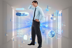 Composite image of thoughtful businessman with hand on head Royalty Free Stock Photography