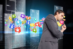 Composite image of thoughtful businessman holding pen Stock Photography