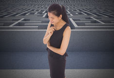 Composite image of thoughtful businesswoman Stock Image