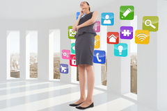 Composite image of thoughtful businesswoman Royalty Free Stock Photos