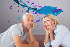 Composite image of thoughtful couple lying and looking up Stock Photos