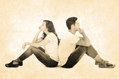 Composite image of thoughtful couple sitting on floor back to back Stock Photography