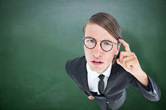Composite image of thoughtful geeky businessman Stock Images