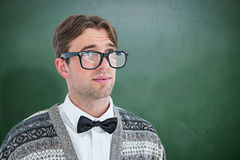 Composite image of thoughtful geeky hipster Royalty Free Stock Photos