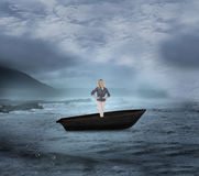 Composite image of thoughtful gorgeous blonde in a sailboat Royalty Free Stock Images