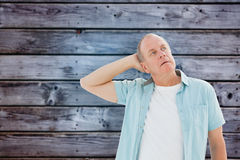 Composite image of thoughtful older man looking up Stock Photography