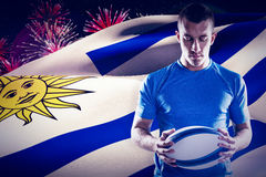 Composite image of thoughtful rugby player holding ball Royalty Free Stock Photography