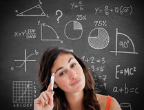 Composite image of thoughtful student doing her homework Royalty Free Stock Photo