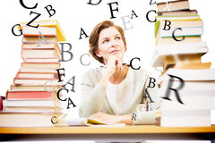 Composite image of thoughtful teacher at library Stock Image