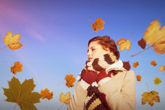 Composite image of thoughtful woman in winter clothes Stock Images