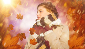 Composite image of thoughtful woman in winter clothes Royalty Free Stock Photography