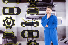 Composite image of thoughtful young male mechanic Stock Images