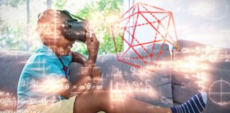 Composite image of three dimension image of hexagon shape. Three dimension image of hexagon shape against side view of boy wearing virtual reality headset at Stock Photography