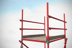 Composite image of three dimension image of red scaffolding 3d. Three dimension image of red scaffolding against blue sky with clouds 3d royalty free stock photography