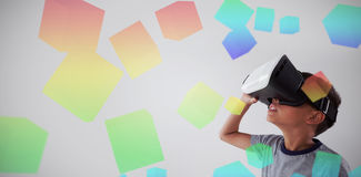 Composite image of three dimension image of square with formulas. Three dimension image of square with formulas against schoolboy using virtual reality headset Stock Image