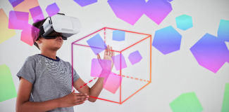 Composite image of three dimension image of square with formulas. Three dimension image of square with formulas against schoolboy using virtual reality headset Royalty Free Stock Image