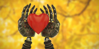 Composite image of three dimensional image of cyborg holding heart shape decoration 3d Stock Image