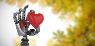 Composite image of three dimensional image of robot showing red heard shape decoration 3d Royalty Free Stock Photography