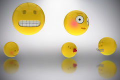 Composite image of three dimensional image of various smileys faces reactions 3d. Three dimensional image of various smileys faces reactions against grey Stock Photography