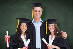 Composite image of three friends graduate from college together Royalty Free Stock Image