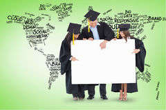Composite image of three graduates pointing to the blank sign Stock Photos