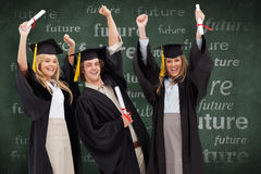 Composite image of three students in graduate robe raising their arms Royalty Free Stock Image