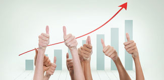 Composite image of thumbs raised and hands up Stock Photo
