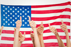 Composite image of thumbs raised and hands up Royalty Free Stock Photo