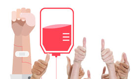 A composite image of thumbsup. A thumbsup against blood donation Stock Photos