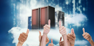 Composite image of thumbsup. Thumbsup against cityscape on cloud Royalty Free Stock Photography
