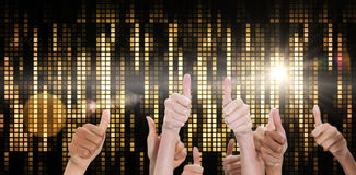 Composite image of thumbsup. Thumbsup against digitally generated cool pixel background Royalty Free Stock Image