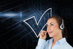 Composite image of tick symbol and call centre worker Royalty Free Stock Image