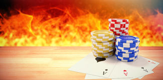 Composite image of tilt image of playing cards with casino tokens Stock Photos