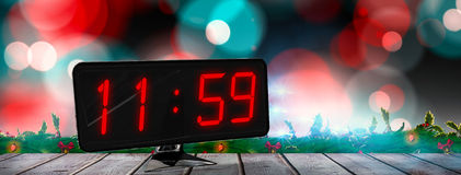 Composite image of time displayed on digital clock Royalty Free Stock Photos