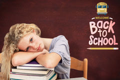 Composite image of tired teeenager sleeping in a library Stock Photography