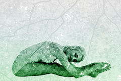 Composite image of toned woman doing the paschimottanasana pose Royalty Free Stock Photo