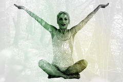 Composite image of toned young woman sitting with arms outstretched Royalty Free Stock Images