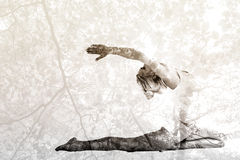 Composite image of toned young woman stretching hands backwards Stock Photo