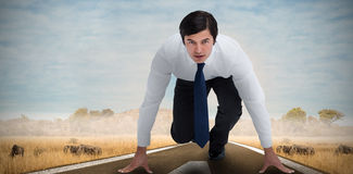 Composite image of tradesman in sprinting position Royalty Free Stock Photography