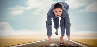 Composite image of tradeswoman in sprinting position Royalty Free Stock Photography