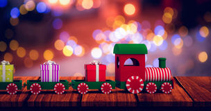 Composite image of train set with gift boxes Royalty Free Stock Photo